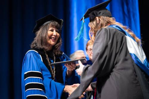 President Mantella with graduate student at commencement